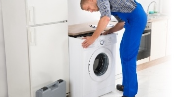 handyman installing washing machine